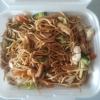 Pad Mee Kee Mao - Äggnudlar med kyckling, grönsaker och basilika.
