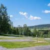 Campingplats för husbil och husvagn med utsikt mot Kalvsjön