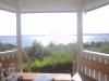 Utsikt från lusthuset. Jättefint stället att läsa bok på!