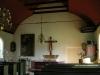 Den gamla altartavlan av Hendrik Krogh hänger numera över dopaltaret