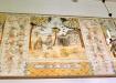 Sviten av målningar sedda från läktaren