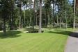 Kyrkogården i skogen
