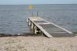Den lilla bryggan på stranden