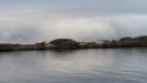 Risö.En bild tagen från båten . Man kan se alla bygnader och bryggor och badplats