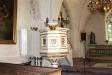 I södra korsarmen står en gravsten från andra delen av 1100-talet.