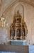 Altaruppsatsen skänktes till kyrkan 1674.