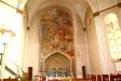 Den stora altarfresken är målad av Hilding Linnqvist 1950-51.