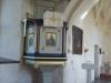 Predikstolen har tre målningar av Axel Hörlin.