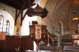Dopfunten av gotländsk sandsten är ritat av Wickman.