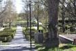 Öster och söder om kyrkan ligger den stora kyrkogården.