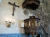 Predikstolen av snidad ek från 1648 med skulturer av fyra evangelisterna.