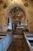 Sakristian finns bakom altaret.