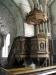 Närbild av Lukas som pryder predikstolen
