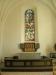 Både glasmålningen och altarskåpet  är verk av Harald Lindberg