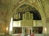 hänger över en målning av Flens kyrka förr i tiden.