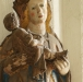 Det gamla skadade altarskåpet ovanför sakristiedörren.