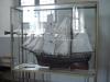 Kyrkskeppet som numera fått plats i en glasmonter i koret.