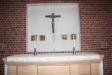 En av de tre altartavlorna.