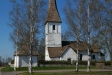 Kyrkan går i samma färgskala som björkarna.
