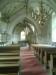 Altaret med krucifix. Korets östfönster med glasmålning.
