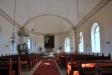 Den gamla trädopfunten från 1661 är förpassad till en hörna under predikstolen