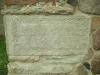 Dekorerad sten inmurad i södra korsarmen