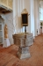 Predikstolen finns kvar från gamla kyrkan och är snidad 1734 av grännamästaren A Ekeberg