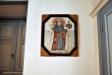 En av åtta trämedaljonger från gamla kyrkan