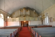 Korset på väggen bakom predikstolen är skänkt av Elias Alegren