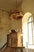 Altaruppsatsen på södra långväggen är ett verk av Johan Ullberg