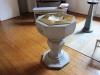 Dopfunten är från 1948 och materialet är ljus granit.