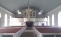 Kyrkorum med orgel och läktare.