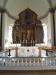 Bakom altarskåpet finns den gamla predikstolen och ett annat altare