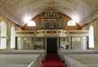 Kyrkorummet med orgelläktarens pampiga fasad.