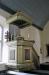 Predikstolen från 1747 har ett vackert bokstöd