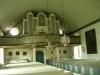 På norra väggen hänger en tidigare altartavla av G.Lindblom