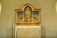 Den lilla altartavlan är målad av konstnären Nils Asplund i Stockholm