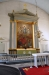 Vid södra långväggen står den gamla altaruppsatsen från 1701.