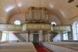 Närbild av det 1904 hårt restaurerade altarskåpet