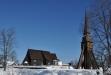 Vintern famnar kyrkan.