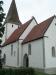 Svårfotograferad kyrka - mycket lövträd i vägen!