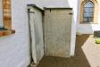 Mot kyrkväggen på utsidan står dessa gamla stentavlor.