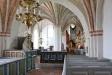 Nere i kyrkan vänstra del står kyrkans orgel.
