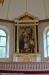 Altartavlan från 1874 målades av Mårten Eskil Winge. Dess motiv är ´Korsnedtagningen´