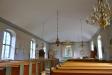 Den gamla altartavlan från 1702 hänger nu på nordväggen