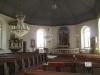 Altartavlan av John Hedaeus är från 1931 och föreställer Jesu bergspredikan.