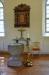 Romansk dopfunt från den tidigare kyrkanoch ett epitafium vars färg tvättades bort 1921!