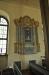 Den tidigare altaruppsatsen från 1758 sitter nu på norra väggen