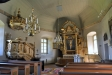 Romanskt tympanon som placerades ini kyrkan 1942