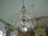 Den 16-pipiga ljuskronan av trä från början av 1800-talet